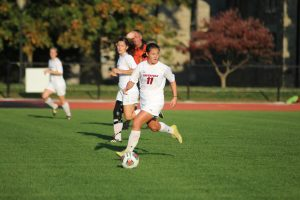 Raina Fitzpatrick '18 takes possession of the ball